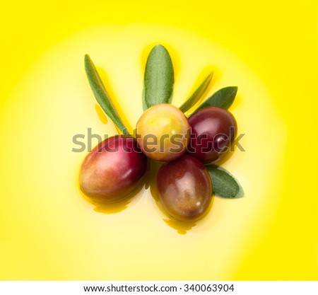 Olives on olive oil - stock photo