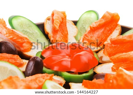 olives salmon and pepper served on dish