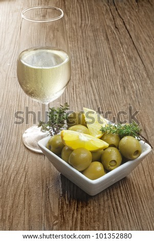 olives tapas and sherry wine - stock photo