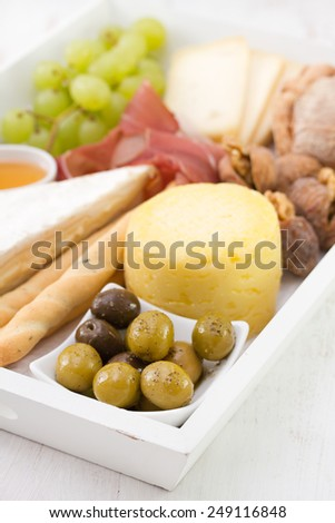olives with cheese, grapes - stock photo
