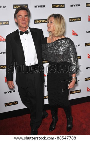 Olivia Newton-John & date at the 2010 G'Day USA Australia Week Black Tie Gala at the Grand Ballroom at Hollywood & Highland. January 16, 2010  Los Angeles, CA Picture: Paul Smith / Featureflash - stock photo