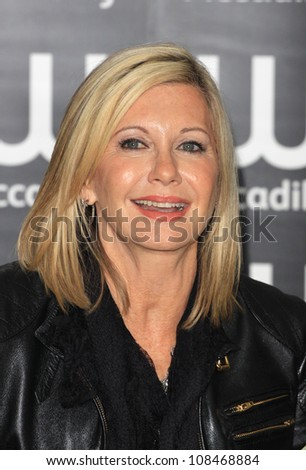 Olivia Newton-John signs copies of her book 'LivWise: Easy Recipes for a Healthy Happy Life' in Waterstones Piccadilly London. 19/04/2012 Picture by: Henry Harris / Featureflash