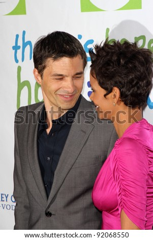 Olivier Martinez and Halle Berry at the Silver Rose Awards Gala, Beverly Hills Hotel, Beverly Hills, CA. 04-17-11 - stock photo