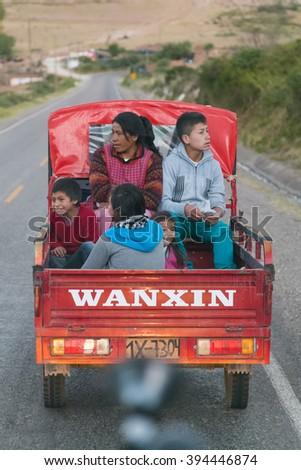 Ollantaytambo, Peru - circa June 2015: Peruvian family riding truck on the road to Cusco, Peru - stock photo