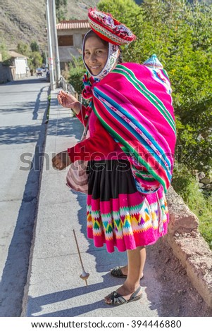 Ollantaytambo, Peru - circa June 2015: Woman in traditional Peruvian clothes in Ollantaytambo, Peru - stock photo