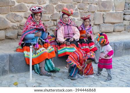 Ollantaytambo, Peru - circa June 2015: Women and children in traditional Peruvian clothes in Ollantaytambo, Peru - stock photo