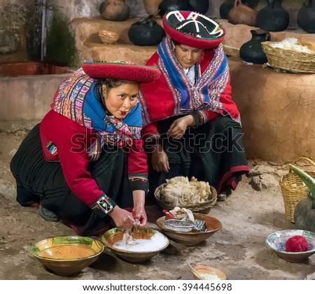 Ollantaytambo, Peru - circa June 2015: Women in traditional Peruvian clothes use natural dyes for Alpaca and Llama wool near Cusco, Peru - stock photo