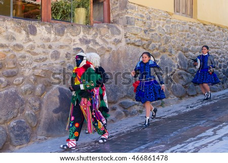 Ollantaytambo, Peru - May 16 : Religious celebration for Fiestas de Pentecostes with people wearing masks and colorful clothing on the streets of Ollantaytambo. May 16 2016, Ollantaytambo Peru.
