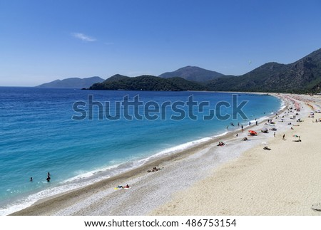 OLUDENIZ, TURKEY - JUNE 04: Tourists visit Oludeniz beach in Turkey on JUNE 04, 2016. Oludeniz beach is one of the best beaches in Turkey, it's situated on Mediterranean Sea