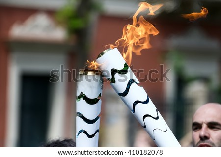Olympia, Greece - April 20, 2016:The torch during the course of the last rehersal of the the lighting ceremony of the flame for the Olympic Games Rio 2016 and the Torch Relay, ancient Olympia, Greece. - stock photo