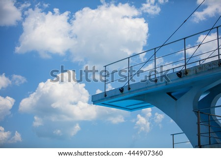 Olympic diving platform from the side with a blue sky - stock photo