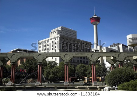 Olympic Plaza, and the Calgary tower - a Calgary tourist attraction with dramatic revolving restaurant for those city views - stock photo