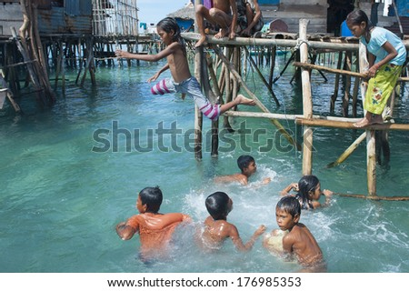 OMADAL ISLAND, SABAH, MALAYSIA - JANUARY 28 : Unidentified Sea Gypsies people on January 28, 2012 in Sabah, Malaysia. The Sea Gypsies are sea nomads that move from one place to another.