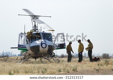 Omak, WA, USA August 21, 2015: Fire fighters on the helicopter crew at the Omak Airport prepare to fight the Okanogan Complex Wild Fire, the largest, most destructive fire in Washington State history