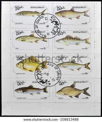 OMAN - CIRCA 1973: A collection stamps printed in Oman showing eight kinds of fish, circa 1973 - stock photo