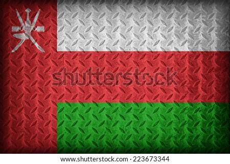 Oman flag pattern on the diamond metal plate texture ,vintage style - stock photo