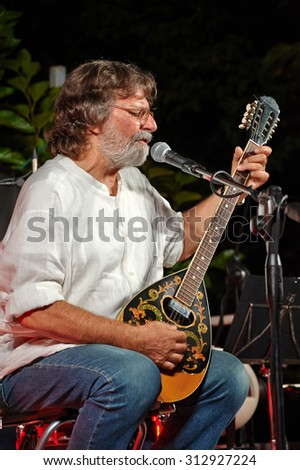 "OME,ITALY - AUGUST 26:  exhibition live of the  italian songwriter Giorgio Cordini at the event ""Acoustic Franciacorta 2015"",26 August ,2015 in Ome,Italy"