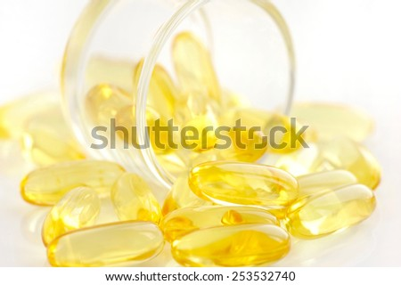 Omega-3 capsules on white background - stock photo