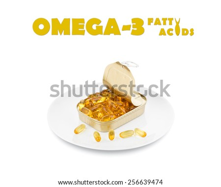 Omega 3 fatty acid capsules from an opened tin on a white plate with a shorter depth of field. - stock photo