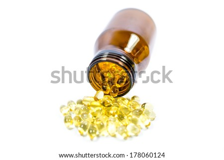 Omega 3 fish oil capsules on a white background - stock photo