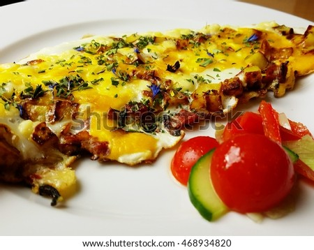 Omelet from eggs with herbs and onions