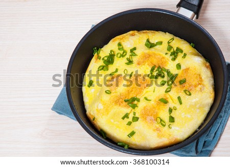 omelet in a frying pan - stock photo