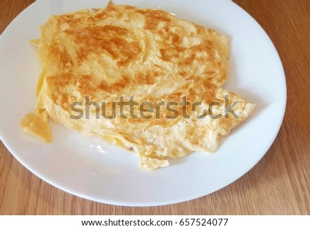 Omelet on white plate, Easy menu of Thai style food