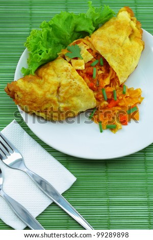 Omelet stuffed with spice. - stock photo