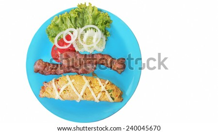 Omelet with bacon served on blue  plate - stock photo