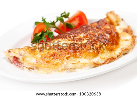 Omelet with herbs and tomatoes isolated on white - stock photo