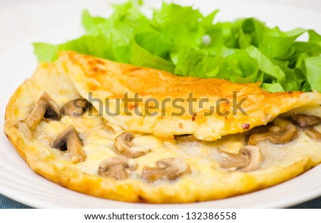 Omelet with mushrooms - stock photo