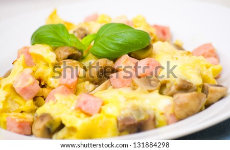 omelet with mushrooms, ham and cheese - stock photo