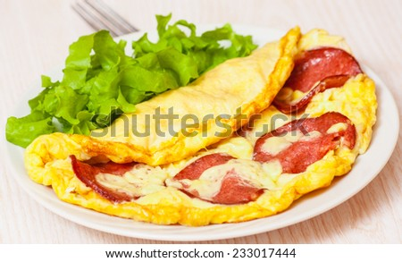 Omelet with salami - stock photo