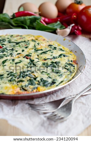 omelet with spinach - stock photo