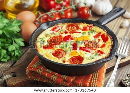 Omelet with vegetables and cheese. Frittata in a frying pan  - stock photo
