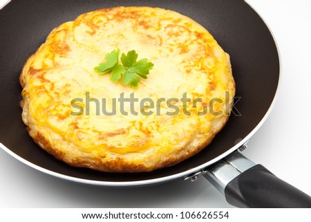 omelette of potato cooked in a frying pan