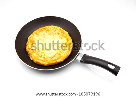 omelette of potato cooked in the frying pan