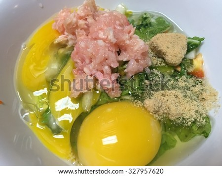 Omelette preparation - stock photo