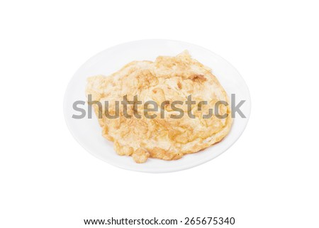 Omelette, typical rolled plain omelette isolated on a white background - stock photo