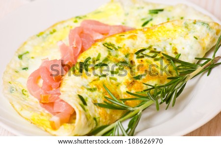 omelette with smoked meat - stock photo