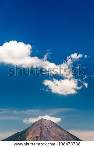 OMETEPE ISLAND, NICARAGUA: Peak of volcano Conception and clouds in a blue sky - stock photo