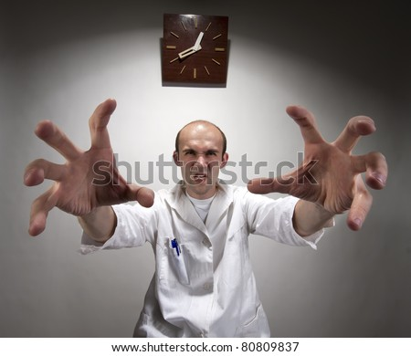 Ominous angry doctor reaching his long hands - stock photo