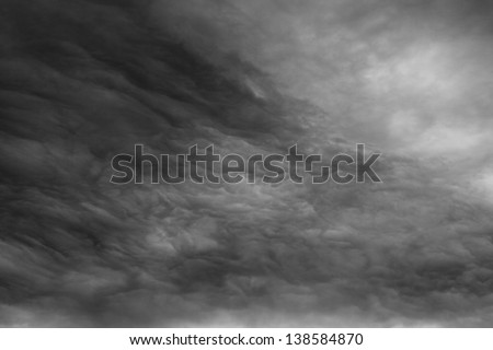 Ominous clouds as if armageddon. The grey storm clouds over horizon. - stock photo