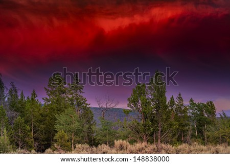 Ominous orange storm clouds in Grand Teton National Park, WY - stock photo