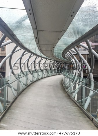 Omni Bridge is criss-crossing steel and glass bridge stretching over Leith Street in Edinburgh, Scotland.