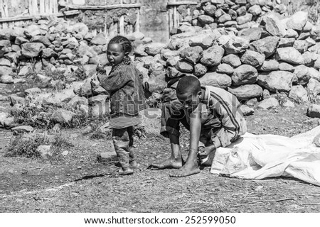OMO, ETHIOPIA - SEPTEMBER 21, 2011: Unidentified Ethiopian boy and woman in the street. People in Ethiopia suffer of poverty due to the unstable situation