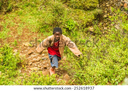 OMO, ETHIOPIA - SEPTEMBER 19, 2011: Unidentified Ethiopian boy runs. People in Ethiopia suffer of poverty due to the unstable situation