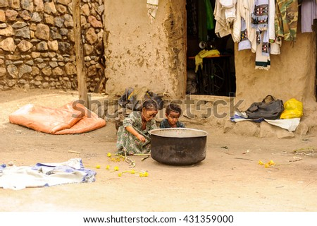 OMO, ETHIOPIA - SEPTEMBER 21, 2011: Unidentified Ethiopian children outdoors. People in Ethiopia suffer of poverty due to the unstable situation - stock photo