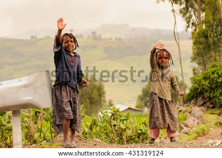 OMO, ETHIOPIA - SEPTEMBER 21, 2011: Unidentified Ethiopian girls in the street. People in Ethiopia suffer of poverty due to the unstable situation - stock photo
