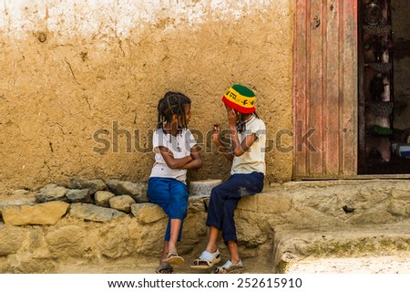 OMO, ETHIOPIA - SEPTEMBER 21, 2011: Unidentified Ethiopian girls near a house. People in Ethiopia suffer of poverty due to the unstable situation